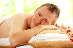 Man resting in spa salon Stock Photography