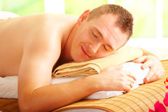 Man resting in spa salon Stock Images