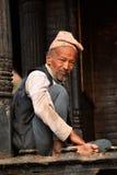 Man resting on the streets of Kathmandu Stock Photos