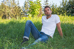 Man resting in a summer park Stock Image
