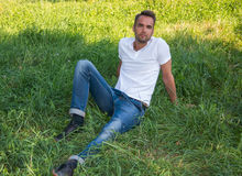 Man resting in a summer park Stock Photography