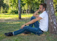 Man resting in a summer park Royalty Free Stock Images