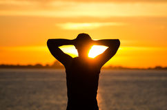 Man resting at sunrise Stock Photography