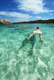 Man resting on the water. Stock Image