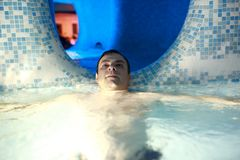 Man resting in water park Royalty Free Stock Images