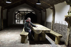 Man resting in wine cellar Royalty Free Stock Photography