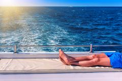 A man resting on a yacht stock photography