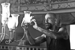 Man restoring a chandelier Stock Images