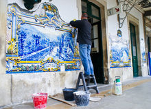 Man restoring old tiles Royalty Free Stock Photography