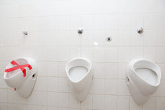 Man restroom with three urinals/pissoirs Stock Photo
