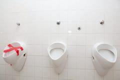 Man restroom with three urinals/pissoirs Stock Photo