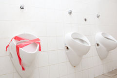 Man restroom with three urinals/pissoirs Stock Photography