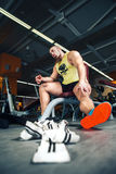 Man rests in gym after having a workout Stock Images