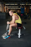 Man rests in gym after having a workout Stock Photography