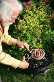 Man rests the sausages Stock Photos