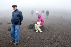 A man rests whilst walking up Cotopaxi which is an active strato volcano in Ecuador. Stock Photos