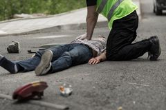 Man resuscitating car crash victim. Picture of men resuscitating male car crash victim Royalty Free Stock Photos