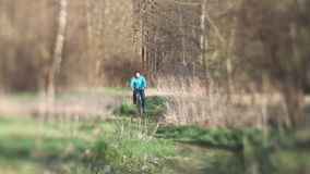 Man on retro bike rides in the woods stock video footage