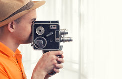 Man with retro camera Royalty Free Stock Photos