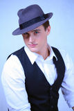 Man in retro fashion. Young handsome man in blue hat, a retro fashion portrait Royalty Free Stock Photo