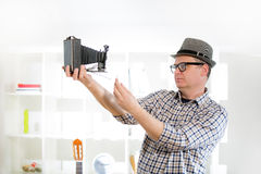 Man with retro film camera Royalty Free Stock Image