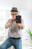 Man with retro film camera Royalty Free Stock Photo