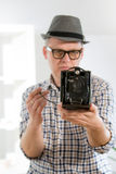 Man with retro film camera Stock Image