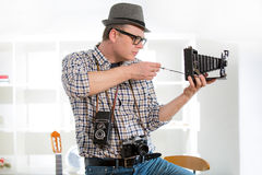 Man with retro film camera Stock Images