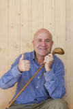 Man with retro golf stick Stock Image