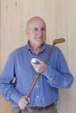 Man with retro golf stick Stock Photography