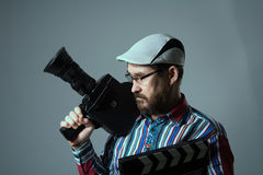 Man Retro movie camera and clapper Stock Photography