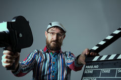 Man Retro movie camera and clapperboard Royalty Free Stock Photo