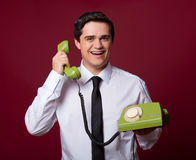 Man with retro phone Stock Images