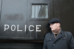 Man and retro police carriage Stock Photo