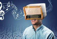 Man with retro radio on the head Royalty Free Stock Photo