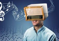 Man with retro radio on the head Royalty Free Stock Photo
