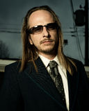 Man in Retro Suit Wearing Sunglasses Royalty Free Stock Image