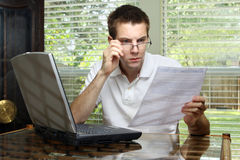 Man reviewing application Royalty Free Stock Images