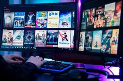 Man reviews the movie offer in netflix. WROCLAW, POLAND - FEBRUARY 02th, 2018: Netflix is an American entertainment company specializes in and provides streaming royalty free stock image