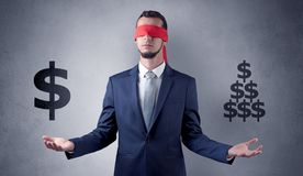 Man with ribbon on his eye holding dollar signs Stock Image