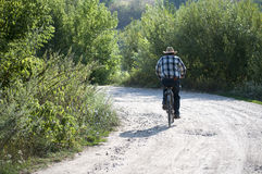 Man ride bicycles in the forest Royalty Free Stock Images