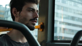Man ride on a bus. Young man watching through window in a bus stock footage
