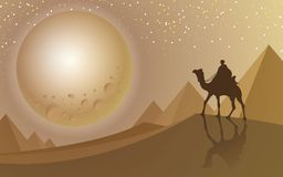 Man ride a camel looking to the full moon at desert and pyramid stock images