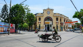 A man ride cyclo in front of  a central post office Royalty Free Stock Photos