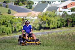Man ride on lawn mower Stock Photos