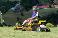 Man ride on lawn mower Royalty Free Stock Images