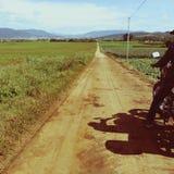 Man ride motorbike in long way trip Stock Image