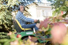 Man on ride on mower Stock Photo