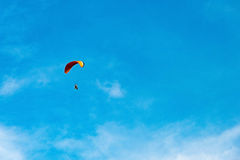 Man ride Paramotor flying in the sky Stock Photography