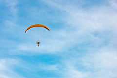 Man ride Paramotor flying in the sky Royalty Free Stock Image